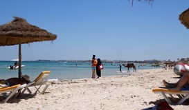 The locals on the beach in the Tunisia coastline camel Stock Photography