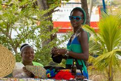 Locals in Bequia, Grenadines, Caribbean. Two  sales women smiling, seafront of Bequia, Grenadines Stock Image