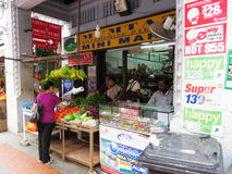 Locals buying fruit and sim card stall Stock Photos