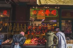 Locals buying fruits in Manhattan  Chinatown stock photography