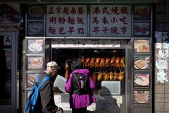 Locals buying roast duck at restaurant in Flushing Chinatown