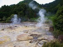 Azores S.Miguel Island Furnas Valley geologic park. Locals cook tipical portuguese food with vulcanic sulfur dioxide steam royalty free stock photo