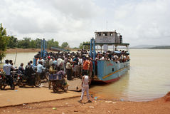 Locals crossing river Sharavathi in South India. Local people and tourists boarding an engine powered boat for crossing Sharavathi River in the Southern province Stock Image