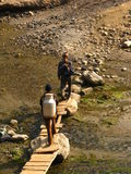 Locals crossing a small bridge on the way to Pokhara Royalty Free Stock Photography