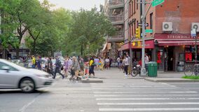 locals crossing 1st Avenue in Downtown New York city