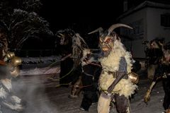 Perchten demons run in December. Locals dressed up as demons and scary monsters roam the streets to drive away the winter in a centruries old tradition Royalty Free Stock Photos