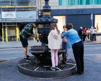 Locals drinking water from the Canaletas fountain Royalty Free Stock Photos