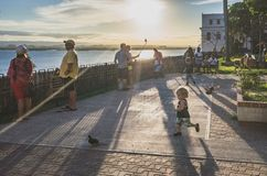 Locals enjoying a sunset view in San Juan. San Juan, Puerto Rico, USA - Jan. 2, 2018: Locals enjoying a sunset view from Parque de las Palomas park of the stock image