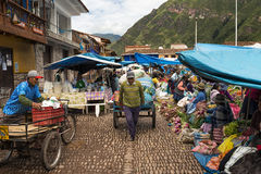 Locals in a market in the city of Pisac, in the Sacred Valley. Pisac, Peru - December, 2013: Locals in a market in the city of Pisac, in the Sacred Valley Royalty Free Stock Photos
