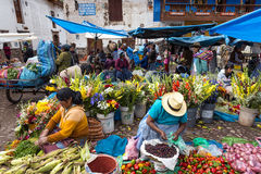 Locals in a market in the city of Pisac, in the Sacred Valley. Royalty Free Stock Photo