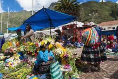 Locals in a market in the city of Pisac, in the Sacred Valley. Pisac, Peru - December, 2013: Locals in a market in the city of Pisac, in the Sacred Valley Stock Photography
