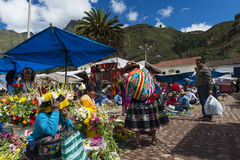 Locals in a market in the city of Pisac, in the Sacred Valley. Royalty Free Stock Photos