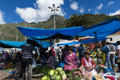 Locals in a market in the city of Pisac, in the Sacred Valley. Pisac, Peru - December, 2013: people in a market in the city of Pisac, in the Sacred Valley Stock Images