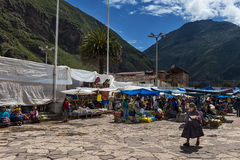 Locals in a market in the city of Pisac, in the Sacredy Valley. Pisac, Peru - December, 2013: Locals in a market in the city of Pisac, in the Sacredy Valley Stock Photos
