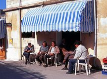 Locals outside a bar, Cyprus. Stock Photography
