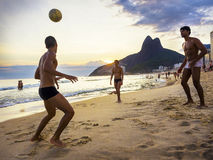 Locals Playing Ball at Sunset in Ipanema beach, Rio de Janeiro, Brazil Royalty Free Stock Photography