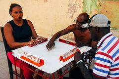 Locals playing dominoes on the street in Havana, Cuba. 3 locals playing dominoes on the street in Havana, Cuba stock photography