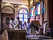 Locals praying inside the Trinity Cathedral or Church of the Holy Trinity in Addis Ababa royalty free stock photo