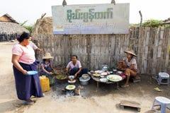 Local Snack Food. Locals prepare local specialities in the village of Hanlin in Myanmar Stock Image