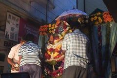 Locals prepare a Shiva deity statue Royalty Free Stock Images