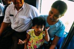 Locals riding the circle train in Yangon. Stock Photo