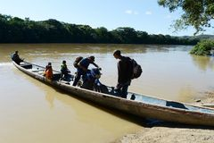 The locals on the river Guayabero. GUAYABERO RIVER, COLOMBIA - NOVEMBER 6, 2012: Guayabero's river in Colombia, after merge to Arjyari form the deep river royalty free stock image