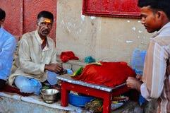Locals in Varanasi, India. Locals sells goods in Varanasi, India stock photography