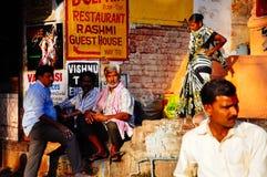 Locals sit in Varanasi, India. Locals sit in the sunset in Varanasi, India royalty free stock image