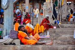 Locals sit in Varanasi, India. Locals sitting on the steps in Varanasi, India stock photos