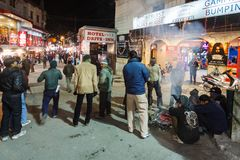 Locals spending time at Mall Road, Mussoorie. Locals and tourists at Mussoorie Mall Road on a cold winter night. Mall road is seen decorated for the christmas Royalty Free Stock Photography