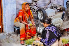 Locals talking in Udaipur, India. Locals talking to each other in Udaipur, India stock photos