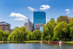 Locals and tourists enjoying a ride on the famous swan boats in. BOSTON, USA - MAY 20: Locals and tourists enjoying a ride on the famous swan boats at the Boston Royalty Free Stock Image