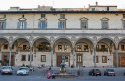Ospedale degli Innocenti - Florence. Locals and tourists in front of the Hospital of the Innocents (Ospedale degli Innocenti) on Piazza della Royalty Free Stock Photo