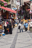 Locals and tourists mingle in the backstreet market Stock Photography