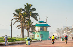 Locals and tourists near the lifesaver's station on The Golden Mile promenade Stock Photos