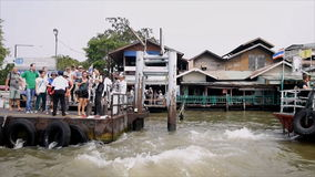 Locals and tourists are taking a Chao Phraya Boat express stock video footage