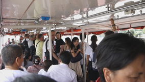 Locals and tourists are taking a Chao Phraya Boat express stock video