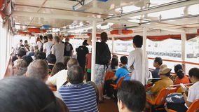 Locals and tourists are taking a Chao Phraya Boat express stock footage