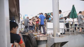Locals and tourists are taking a Chao Phraya Boat express. Bangkok, Thailand - 27 Nov,2014 : Locals and tourists are taking a ChaoPhraya Boat express run on stock video footage