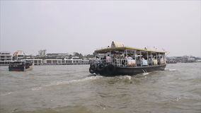 Locals and tourists are taking a ferry Boat on Chaopraya river stock video
