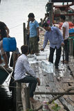 Locals transport an ice Stock Images