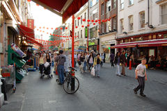 Locals and visitors at Chinatown in London Royalty Free Stock Photos