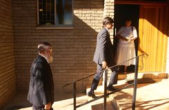Locals walking into a Church in South Africa Stock Photos