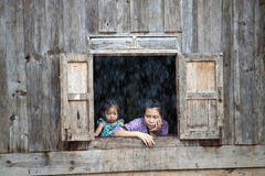 Locals watch monsoon rain Royalty Free Stock Photos