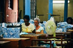 Locals working in a seamstress factory in Havana, Cuba. Locals working hard in a seamstress factory in Havana, Cuba royalty free stock images
