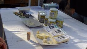 Localy produced cheese in jars at a Swedish harvest festival. Localy produced cheese in jars and to taste at a Swedish harvest festival stock image