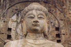 Locana Buddha på Longmen grottor Arkivfoto