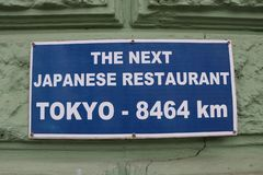 Billboard informs the next japanese restaurant is far away from here. stock image