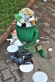 Odessa, Ukraine. June 2019. Full garbage can, with garbage placed on the ground stock photography