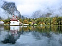 St. Bartholomew`s Church in the quiet Konigsee Lake. Located at a Jurassic rift, Konigsee Lake was formed by glaciers during the last ice age. St. Bartholomew` royalty free stock image